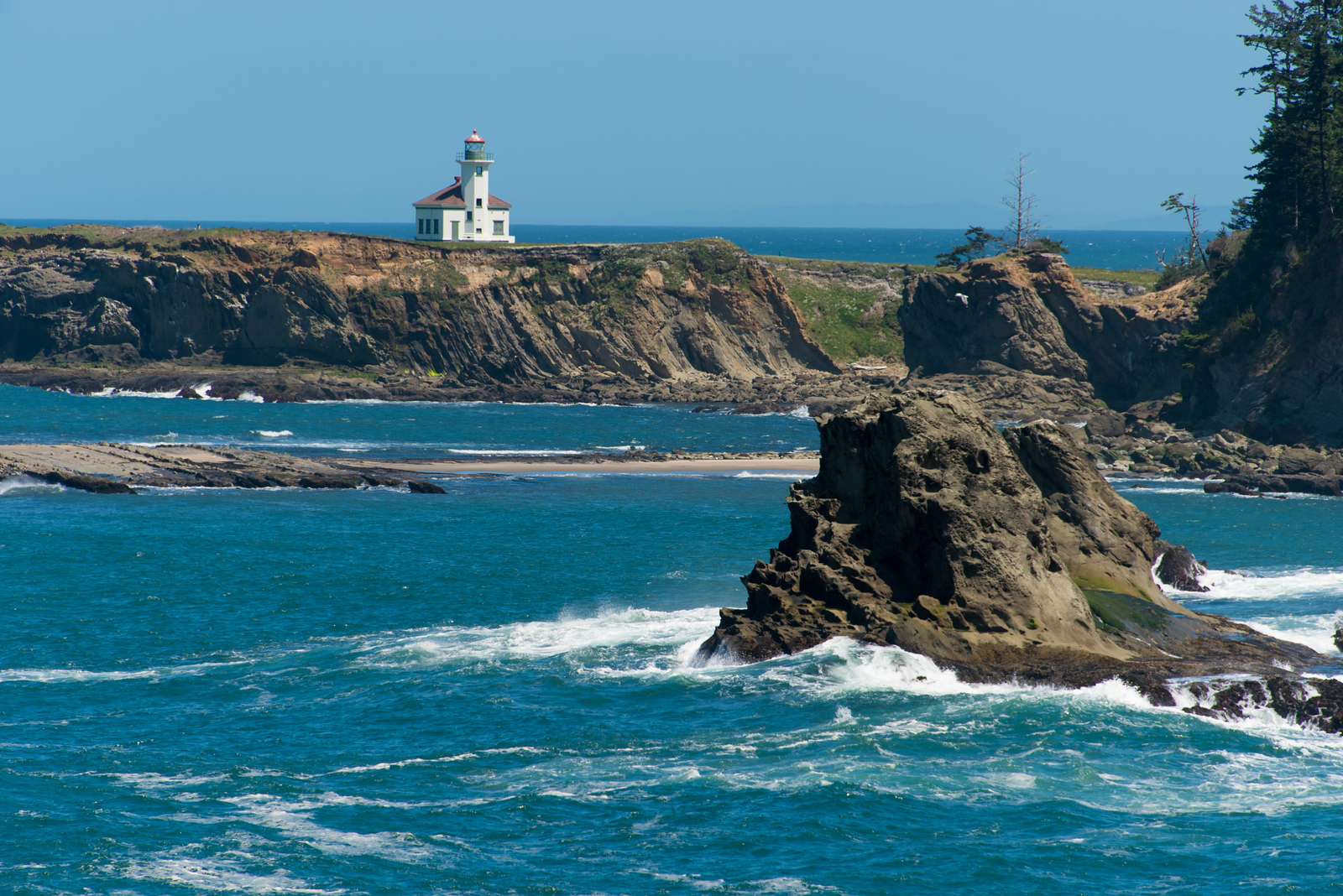 Cape Arago lighthouse on north end of sunset bay.