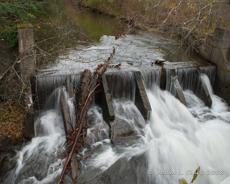 Across the street and less than 100 feet upstream is this old dam