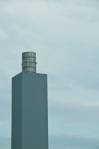 Strange smokestack on a Ford pant. It looks like a bucket on a tower.