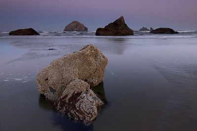 Bandon, Oregon  More early morning shooting.  Again , I used a wide angle lens to capture foreground and background along with a 2 stop graduated neutral density filter.  I tried keeping the rock formations  separated.