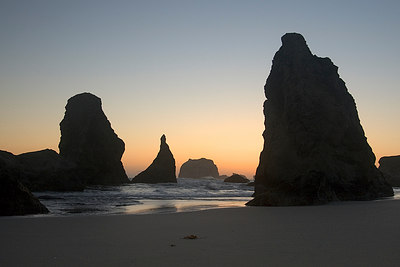 Bandon, Oregon  I had scouted this location hours before the sun set.  We anticipated where the sun would set and tried to find an interesting composition with the sea stacks.    I tried my best to keep find a position that would best keep the sea  stacks separated.