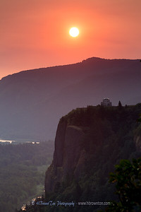 Orange sunrise over Vista House -- Columbia River Gorge
