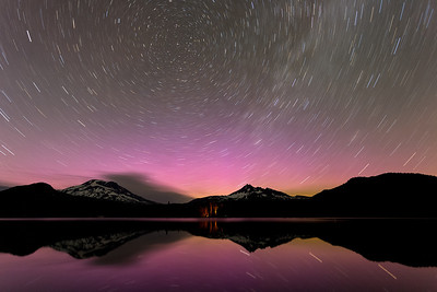 Aurora Trails - Sparks Lake, Oregon  After seeing so many incredible images yesterday from the Aurora, I decided to take a little trip, a 18 hour trip that is!  It was 1pm when I decided to go and was out the door by 2pm and on my way to Sparks Lake, Oregon. I definitely didn't plan to well, not that I had to much time to. Service wasn't great at all. When I got there I wasn't exactly sure where to go, so I took a road around the lake trying to find this shot. I got lucky and drove right to it, all at around 9:30pm. I got some shots just before it got really dark and then started to timelapse for a bit. I think I was a night late on the Aurora though. At least from the pictures I saw from the night before I was. I still got some pinks though. But not much you could see with the naked eye. But all the color was pretty much gone by midnight anyways. I am glad I got there when I did or I would have missed it all.  I drove around to get some Milky Way reflections and then decided I got what I came for. Sleep in my car or drive was my question? 1:30am and I decided to hit the road. I was hoping to get somewhere interesting by sunset, maybe I should have stayed and got sunset at the lake :) Next time! But I was around Shasta Lake in Redding, CA for sunset and blue hour. And during blue hour it looked so surreal from the road. I took about 4 different exits, drove back and fourth and down all these random roads looking for somewhere to get a shot. I couldn't find anything at least not before the sun came up. So in disappointment I drove the rest of the way home and was in bed by 9am. That sure was a fun, quick little trip! Definitely will be doing more of these :)  Canon 5D MK III Canon 17-40mm f/4 L ISO 320 f/4.0 907 Seconds