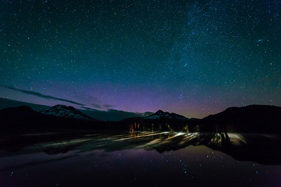Car Lights Over Sparks Lake Here is a frame from a timelapse I got up at Sparks Lake this past July. There is a little bit of the Aurora showing as well. I added a little blue to this, but was stuff for a while debating the white balance. The car lights over the lake are from Brad Goldpaint's buddy. Check out Brad's star photographs, he has some incredible Aurora shots from here the night before.