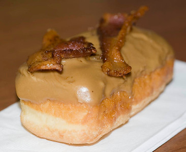 The famous maple-glazed bacon donut from Voodoo Doughnut, Portland.