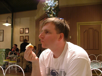 "AC enjoys a croissant in ""France"""