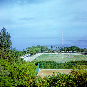 """Looking over the American University of Beirut athletic field toward the Mediterranean. Even in 1968, I was surprised to find an institution called """"American"""" in Lebanon. Even more surprising, AUB still exists today (2019) and is still called the American University of Beirut. Believe it or not at one time Americans were not uniformly despised in the  Middle East. Unfortunately, we've been working hard to earn the region's enmity for decades."""