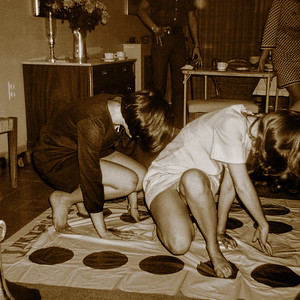 Two ACS girls getting bent playing Twister.  I wasn't planning on looking up dresses when I triggered this snapshot. What you see is a happy accident.