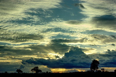Northern Ghanaian sunsets in the rainy season could make your day. I shot this one in the backyard of my second bungalow.