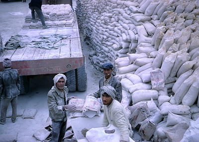 Iranian oilfield workers handling drilling mud bags in 1968. It's not well known but drilling mud is an unsung oil business hero. It simply would not be possible to drill most oil wells without it. It lubricates drill pipes and suppresses blowouts. Mud chemistry is complex and demanding and a vast mud supply industry works quietly in the background making the entire petroleum enterprise possible. Take away drilling mud and the global economy and green gas emissions will simultaneously collapse.
