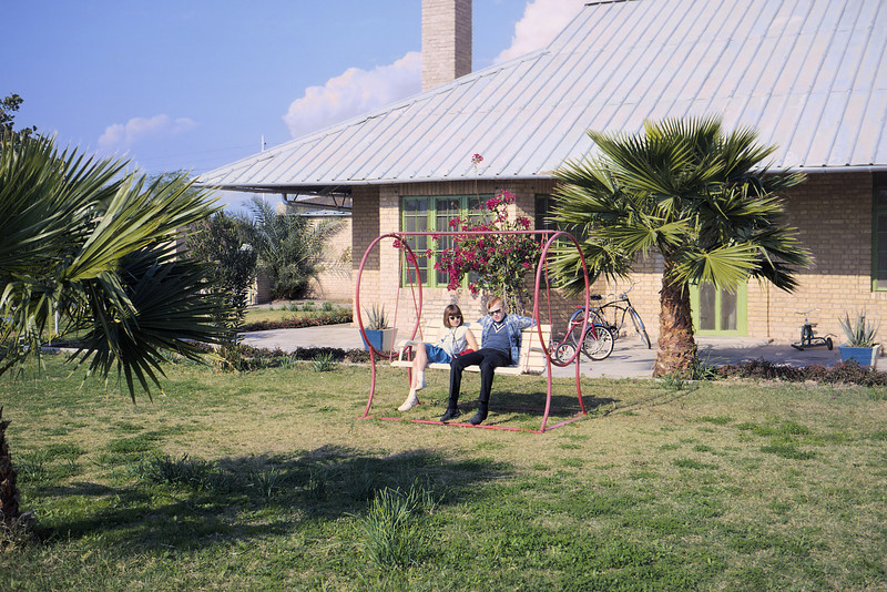 Me and my sister, sporting stylish shades, on a lawn swing. Agha Jari Iran.