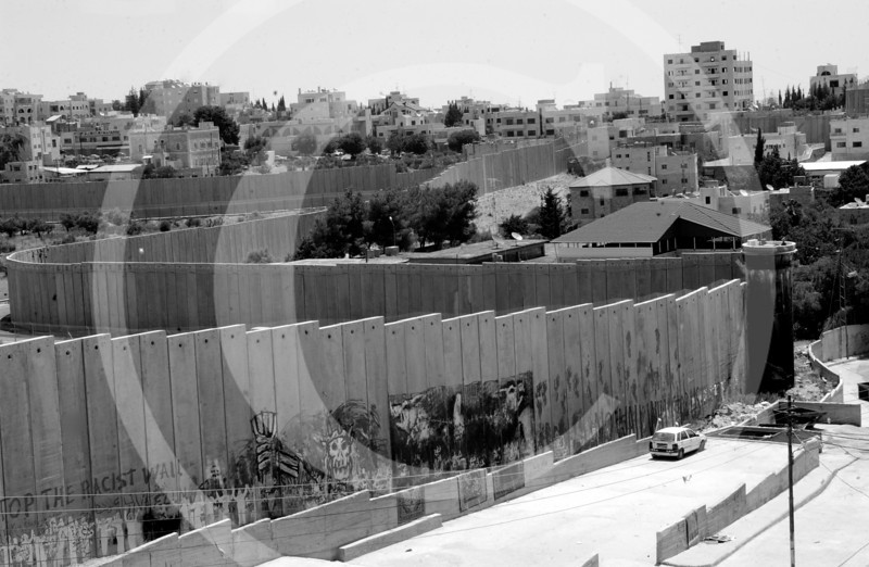 The wall that wraps around Bethlehem looking like a snake, this is the new symbol of the wall for the Palestinians.