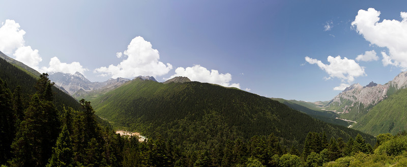 Huanglonggou, Sichuan Province<br /> <br /> The view of Huanglonggou or Yellow Dragon Valley which traverses the picture from left to right.  Xuebaoding pass and the road to Ziuzhaigou are on the right.