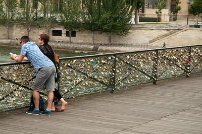 All over Europe people show their love to each other by attaching a lock to bridge railings and throwing the key in the river. If you don't have a lock, there is usually a vendor sitting nearby to sell you one. This one @ the walking bridge Paris, France.