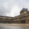 Grey moving back in over the Sully wing of the Louvre