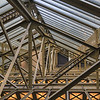 Light through the glass ceiling into the ironwork