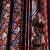 Sunlight through stained glass, dappling colored light