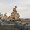 Statues perched on the ledges of the Musee D'Orsay