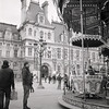 Father and daughter at th Carousel at the Hotel de Ville