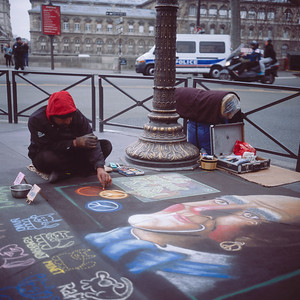 Street Artist in front of the Hotel de Ville