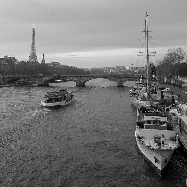 River Seine boats with Eiffel Tower, Paris
