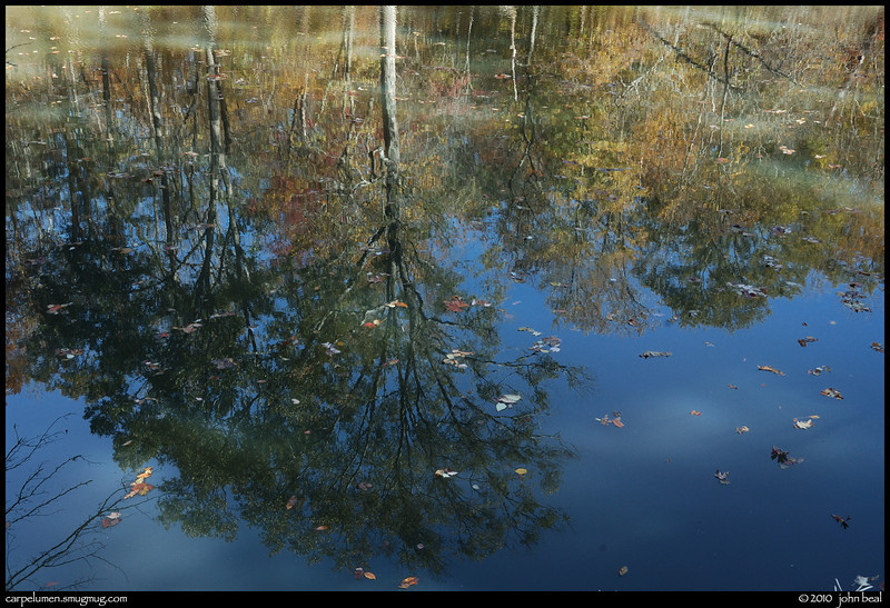 "13Nov10  autumn reflection in sweetwater creek.  <a href=""http://carpelumen.smugmug.com/Photography/2009/November09/10158540_QLM7i/1/714193666_QY8qR/Medium"">one year ago.</a>  f/11, 1/30s, iso 200."