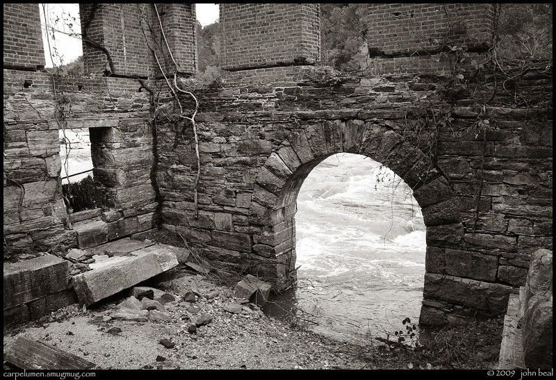"""(13Oct09)  remnant from the past.  the arch leads from the mill, back to the creek.  an interior shot of the  new manchester mfg mill, alongside sweetwater creek, shows the exit point for the water that used to drive the mill's machinery.  the mill was destroyed in the civil war during sherman's march to the sea.  <a href=""""http://carpelumen.smugmug.com/Photography/2008/October08/6118293_quZJt/2/395048335_UfcZq/Medium"""">one year ago.</a>  f/10, 1/400s, iso 640."""