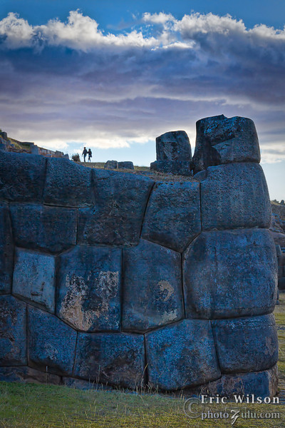 """Saqsaywaman at dusk.<br><br><span class=""""subcaption"""">(Note how small the people are compared to the stones.)</span>"""