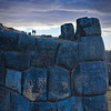 "Saqsaywaman at dusk.<br><br><span class=""subcaption"">(Note how small the people are compared to the stones.)</span>"