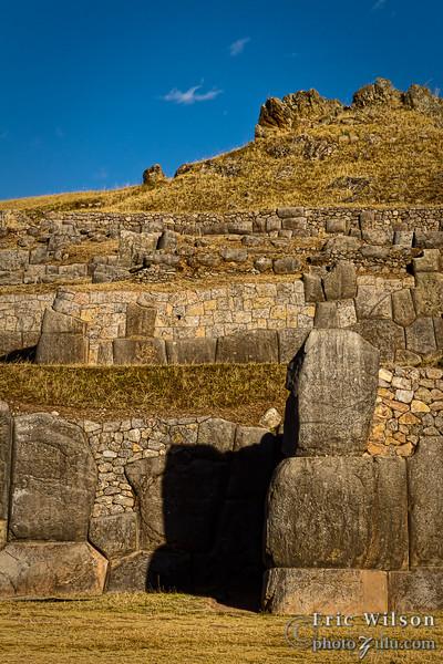 Saqsaywaman fortress ruins at dusk.