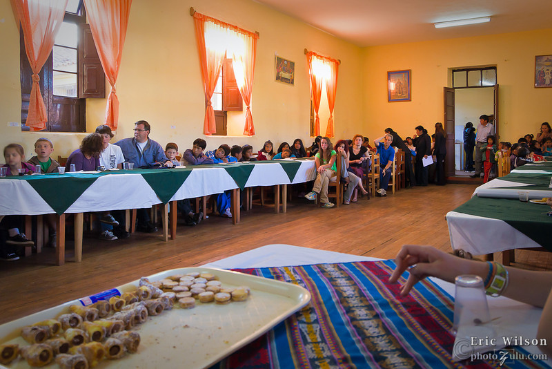 """Theater in the rectangle.<br><br><span class=""""subcaption"""">(Our group and many of the orphanage youth sat around the edges of this long room while others performed dances and music. They also gave us traditional snacks.)</span>"""