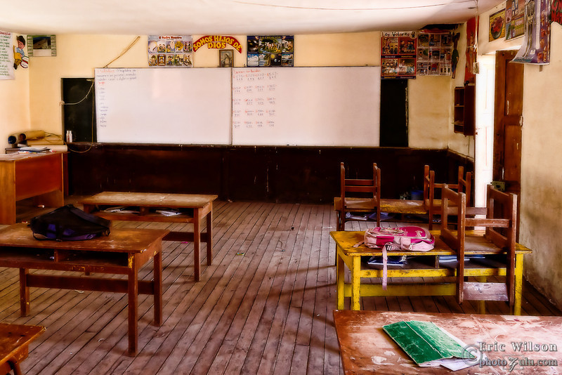 "One of the rooms in Punacancha's village school. <br><br><span class=""subcaption"">(Most villagers speak Quechua, the traditional Incan language, and not Spanish. By fostering a basic school the next generation can have a leg up with basic math, science, and Spanish so they can better trade goods with the cities in the valleys below.)</span>"