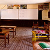 """One of the rooms in Punacancha's village school.<br><br><span class=""""subcaption"""">(Most villagers speak Quechua, the traditional Incan language, and not Spanish. By fostering a basic school the next generation can have a leg up with basic math, science, and Spanish so they can better trade goods with the cities in the valleys below.)</span>"""