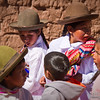 Kids in Punacancha chat as they ready to put on a show.