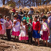 Kids line up to watch the groundbreaking for a new village project.