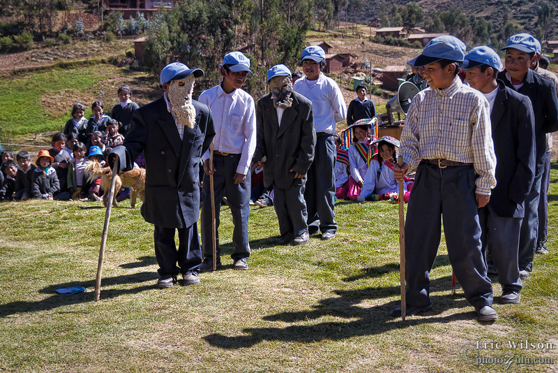 "Young men act out one of their cultural traditions. &nbsp;<br><br><span class=""subcaption""> (I never did figure out which masks represented what nor exactly what story the dances told. I highly recommend studying Quechua before going to the high Andes villages.)</span>"