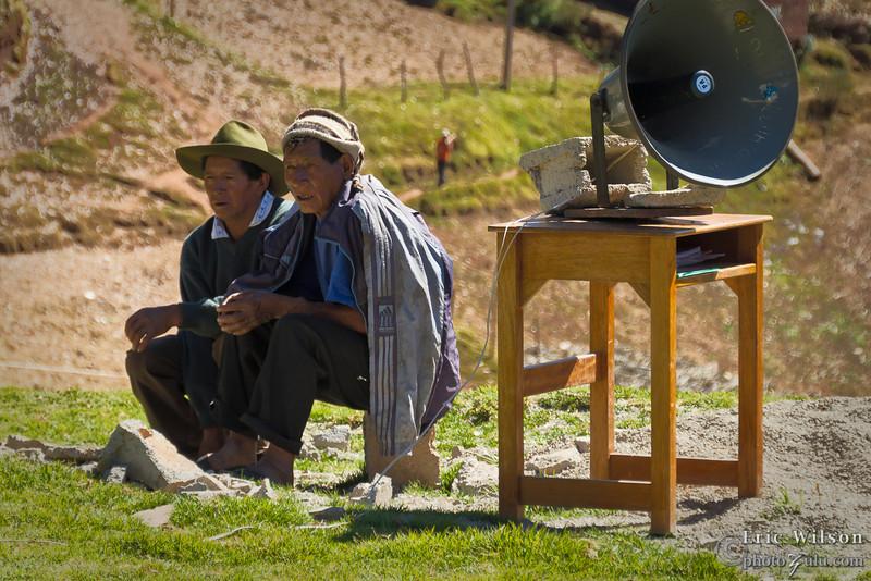Gentlemen close to the village's sound system.