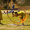 "Jumping through hoops.&nbsp;<br><br><span class=""subcaption""> (After sprinting to other villages carrying logs, you never know when flaming hoops will bar the way home.)</span>"