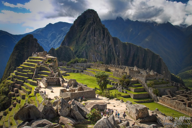 Machu Picchu main courtyard, Intihuatana astronomical point (upper left), and worker residences.