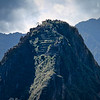 "Huayna Picchu &nbsp;<br><br><span class=""subcaption""> (Inca carved steps to the top of this peak flanking the city below. Today the tourist bureau only permits a limited number per day to climb it and the list fills up usually by early morning.)</span>"