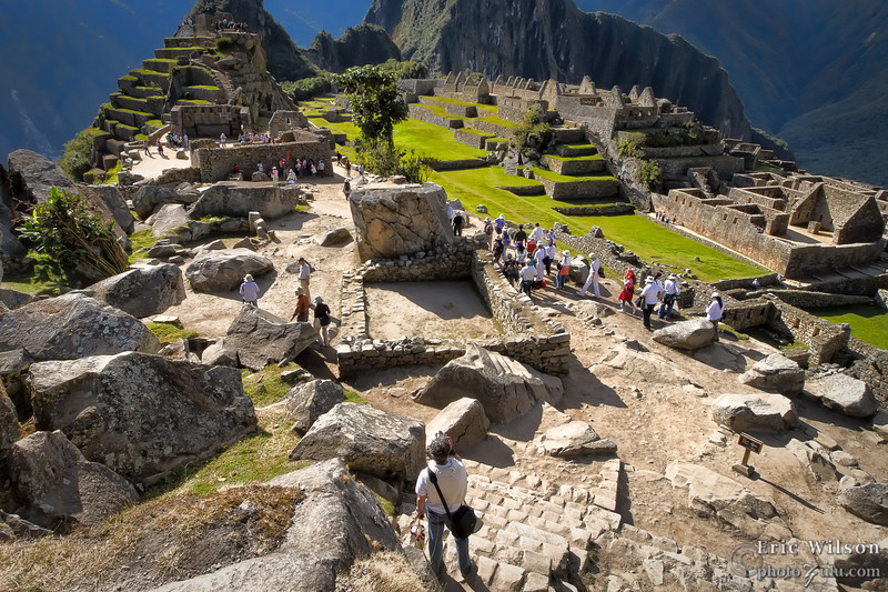 "Toward the center courtyard. &nbsp;<br><br><span class=""subcaption""> (This more typical view shows the crowds of tourists that accompany any visit to the Machu Picchu ruins. Getting shots with few people is sometimes difficult.)</span>"