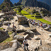 "Toward the center courtyard.  <br><br><span class=""subcaption""> (This more typical view shows the crowds of tourists that accompany any visit to the Machu Picchu ruins. Getting shots with few people is sometimes difficult.)</span>"