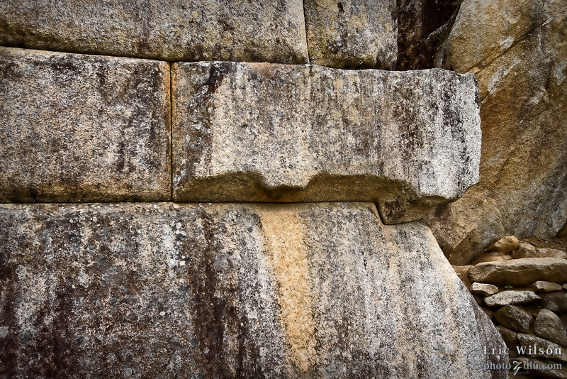 """Stone placement detail. &nbsp;<br><br><span class=""""subcaption""""> (From unfinished stones they can tell the Incan workers used protrusions on the stones to help move them and fit into place and then would carve them off for a nice finish.)</span>"""