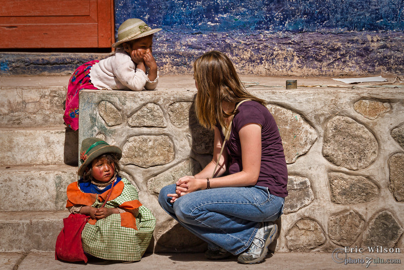 """Rachel practices some Spanish while conversing with the locals.<br><br><span class=""""subcaption"""">(While the natives speak a dialect called Quechuan, the kids in the village are starting to learn Spanish during their schooling.)</span>"""