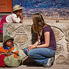 "Rachel practices some Spanish while conversing with the locals. <br><br><span class=""subcaption"">(While the natives speak a dialect called Quechuan, the kids in the village are starting to learn Spanish during their schooling.)</span>"