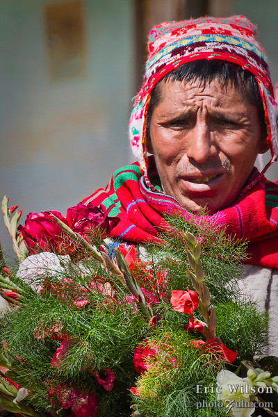 "Flowers of gratitude.&nbsp;<br><br><span class=""subcaption""> (Lamay villagers gave our group flowers in appreciation of the donations to their village over the years.)</span>"