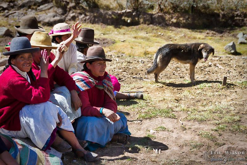 Village women enjoy the kids' performances.