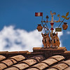 """Bull luck.<br><br><span class=""""subcaption"""">(Numerous symbols decorate rooftops in addition to the typical bulls. Fortune, safety, and warding off evil are just some of this token's skills.)</span>"""