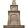 "This is the steeple. <br><br><span class=""subcaption""> (This and next photo are processed more than average to whiten the dismal gray sky and to bring out more texture in the stonework.)</span>"