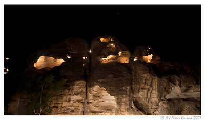 Rock formation with caves, lit in the evening, near Petra
